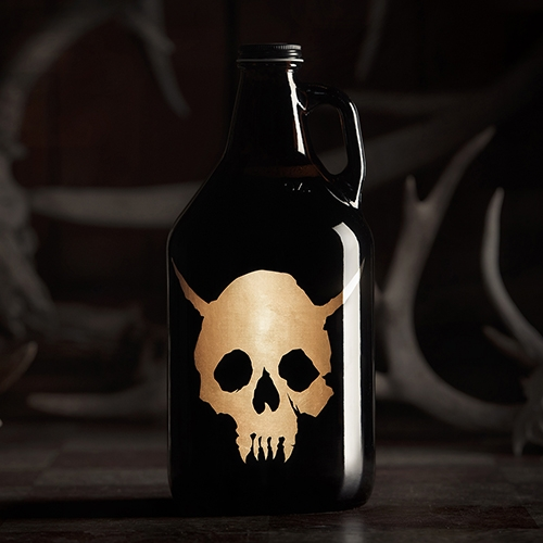 Hired Guns Skull Growler! Made with semi-precious metal, there's no ink on this growler... just gold. Standard 64oz/1.89L glass growler. Perfect for all the beers from all the breweries!