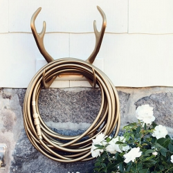 Sweden's Garden Glory - The Reindeer Wallmount and the Gold Digger hose are the perfect unexpected bling for any yard... (also in an assortment of other colors).