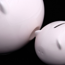 """Piggy is a set of two savings banks that nest together. The larger """"momma"""" bank is for a child's personal savings, and the smaller bank is for the child's charitable savings."""