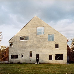 Good House by Preston Scott Cohen.  A restored and re-erected Dutch barn frame is contained in this house like a guitar in its case.