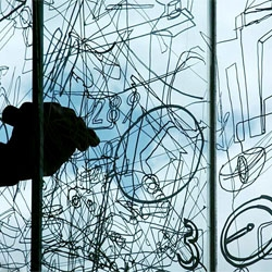 Gosia Wlodarczak's performance 'frost drawing'on glass at Singapore Biennale.