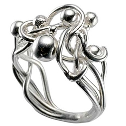 This ring from the Gothic Torrent collection by Catherine Bysheim, is stunning.  In fact, there's lots of great jewelry from independent designers on this site, appropriately called Love2Have.   www.love2have.co.uk