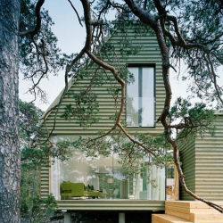 The Ygne summer house is situated on the island of Gotland, one of Swedens most popular summer holiday spots.  The design ambition was to build a house that would recess into the natural environment. By Sandell Sandberg.