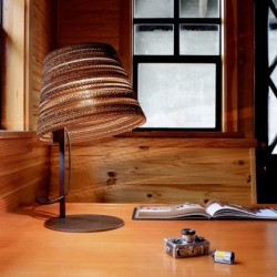 'Tilt' floor and desk series of lamps featuring shades made from cardboard. By Seattle-based graypants.