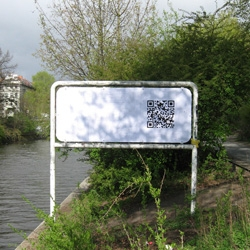 Sweza uses QR Codes to preserve graffiti, photographing graffiti before it is removed by local authorities. Once the graffiti has been removed, he adds a QR Code in the same location, leading to an image of the original.