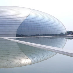 The Grand National Teathre in Beijing China. A giante titanium egg right next to Tiananmen Square becomes a new icon for the city, along with several building opening before the 2008 Olympics.