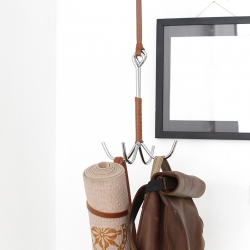 The Grapple Clothing Hook is a minimal organizational system that hangs from the ceiling. Handmade using vegetable-tan leather and horse tack used to hang saddles in barns, it's a stylish addition to a front entrance or bedroom.