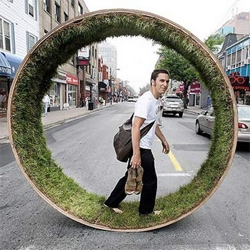 wow, i love it!  a giant running wheel lined with grass.