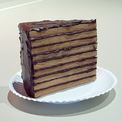 Wooden cake sculptures by artist Greely Myatt.