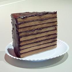 Wooden cake sculptures by artist Greely Myatt.