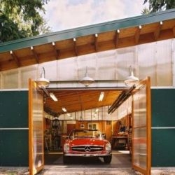 Green Roof Workshop was designed by Harrison Architects for an amateur cabinetmaker and his wife to house his workshop and the couple's prize vintage Mercedes. I love those polycarbonate clerestory windows...