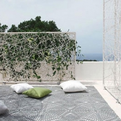 Green Wall designed by Jean-Marie Massaud is a multi-faceted room divider that can be used both indoor and outdoor to define private, undisturbed spaces for breezy relaxation.