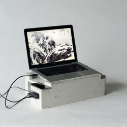 "Foundation is a laptop stand made of concrete. There's space for a 13"" laptop, a hard disk, cell phone and other gadgets. It's somewhere between architecture, design and geekery."