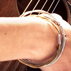 bracelet made from previously played guitar string, from Ben Harper to Ziggy Marley.
