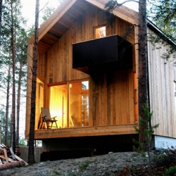 "In a Norwegian wood lies this beautiful house built for a local artist. Simple architectural design by Norwegian ""Huus og Heim Arkitektur""."