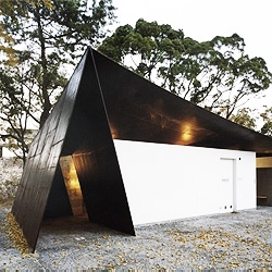 Japanese structure master Shuhei Endo created this public lavatory, covered by a single flat steel sheet made of anticorrosive steel, suspended over a enclosed space.