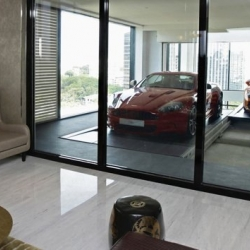 In Singapore's scenic Orchard neighborhood, the 30-story Hamilton Scotts boasts 54 luxurious apartments each with its own 'en-suite sky garage' with room for two vehicles that arrive by way of elevator.