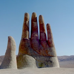Mano de Desierto is a work of the Chilean sculptor Mario Irarrázabal (Uruguay) in the Atacama desert.  The motive of hands rising from the ground is an obsession of Mr. Irarrázabal.