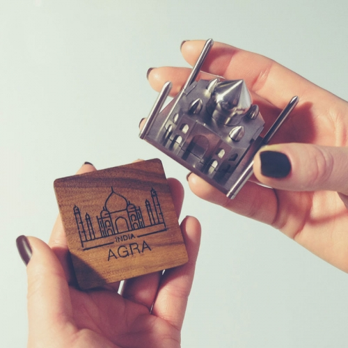 JSOUV by Konstantin Kolesov. 15 architectural landmark souvenirs from around the world in a small sculpture you can hold in your hand. They magnetically attach to the engraved wood bases.
