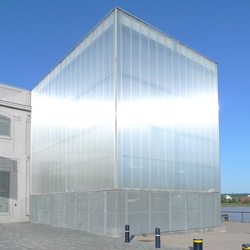This translucent polycarbonate box serves as entrance hall in this warehouse converted into a public events venue along the Bordeaux riverside.
