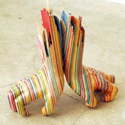 'Screaming my Hand' by Haroshi . Artwork created using old/used skateboards.
