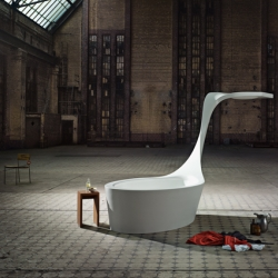 """The """"Swan"""" is a combination bathtub and shower made of Corian. It was designed by Peter Martin for german  manufacturer  Hasenkopf.  The design reminds me of an old wash tub."""