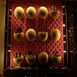 Great window display at Louis Vuitton, Bond St. where ostrich eggs hatch products.