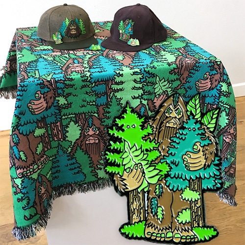 BIGFOOT x Grassroots x Black Book Gallery capsule collection! An amazing blanket, pillow, pins, hats and more.