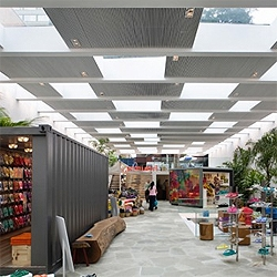 Almost invisible to the street, the sunken flagship store for Havaianas in Sao Paulo has an impressive interior space, filled with green and light, and havaianas of course. By Isay Weinfeld.