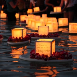 Lantern floating, a Memorial Day tradition at Magic Island, O'ahu.  Thousands of lanterns each covered with messages of hope and remembrance are set adrift in the ocean.
