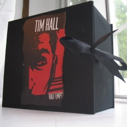 """Half Empty: Kindle Edition"" was created for the Rebuilt Books charity auction at the 2009  Pilcrow Lit Fest in Chicago, using the charred remains of books the author burned."