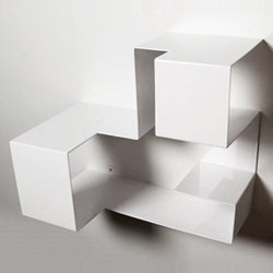 'Sweet Nothing' book shelf by Heart Breakers Design...Its sweet even where there is nothing on it but is also intended as functional shelving, concealing part of its contents in the form.