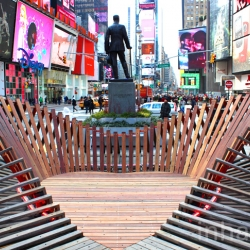 HEARTWALK is a new heart-shaped public art installation in Times Square made of boardwalk planks salvaged after Hurricane Sandy.