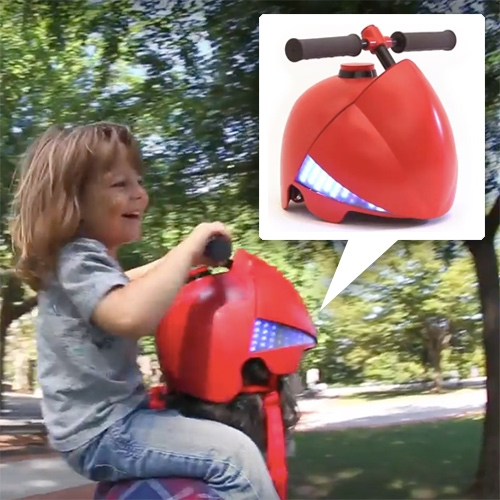 Piggyback Driver helmet by PARTY NY. Kids drive their parents. Turn the handlebars to steer and LED turn signals will flash. Vibrations inside the helmet tell your parents which way to go. Complete with boost and honk buttons.