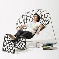 Australian designer Henry Sgourakis' Nook chair and footrest, inspired by paper doilies, it uses over 85 metres of cord.
