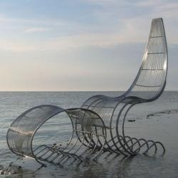Adrian Rayment, along with his father Ron, produce handcrafted metal wirework furniture at their studio in the seaside town of Ramsgate, England. Seen here is the Hero Chair and matching stool.