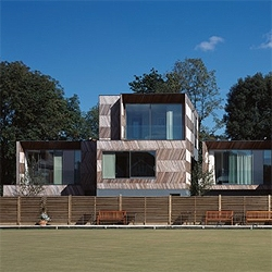 Two house in England countryside, featuring a prefab wood skin with photos from Cristobal Palma