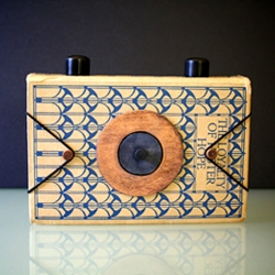 A beautiful pinhole camera created from a vintage hardback book by engrained.