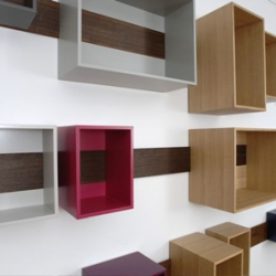 Berlin- based designer, Lutz Huening's wooden board is fixed on the wall and supports a number of boxes, which can be hung, removed, slid freely, and many possible configurations.