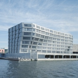 A dynamic shape for the Block 16 building on the Koetsierbaan waterfront is accented by the fish scale-like cladding.