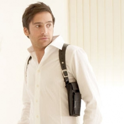 check out the verrry cool holster purse by Koffski (by charles and marie guys)