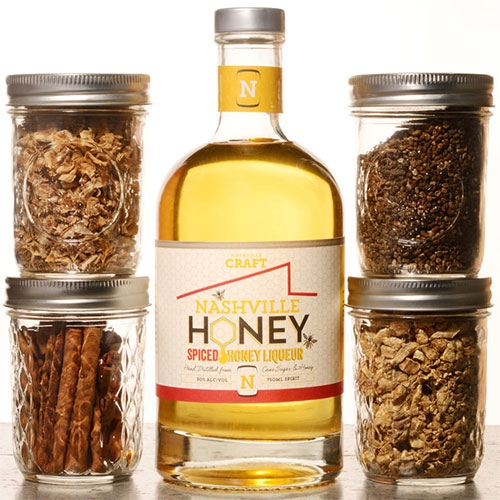 Nashville Honey - a spicy honey liqueur from Nashville Craft. Hand distilled from cane sugar and honey, this small-batch craft spirit is infused with natural ginger, cardamom, lemon peel, and cinnamon.