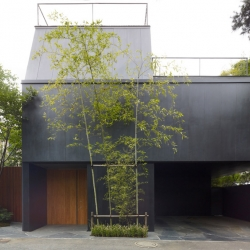 With a chalkboard-like façade nestled between sprightly sprouts of bamboo, The new House S echoes Japanese simplicity.