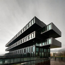 An enigmatic dark volume for the Axis Viana Hotel in Portugal. Stacking overlapping boxes create dramatic perspectives of this building. Love the terraces created on the overlaps.