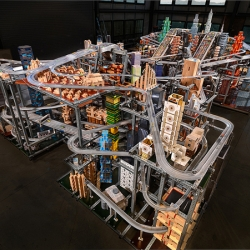 Taking 4 years to complete, Burden's kinetic sculpture Metropolis II is a mesmerizing cityscape where 1,100 toy cars blaze down 18 lanes of freeways in endless loops.