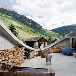 An innovative housing project by SeARCH & Christian Müller, a sliced sphere sunken into the Swiss countryside. The framed view of the landscape as a giant hole is amazing.