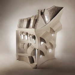 An intricately crafted paper house inspired by the architecture of Amsterdam by English creative Mandy Smith