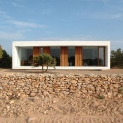 Architect Marià Castelló Martinez designed and built this cool minimalist house and studio for himself on the Balearic island of Formentera.