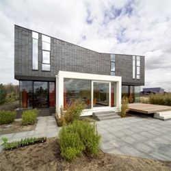 Award winning House M by Marc Koehler. A black heavy volume on top of a transparent public area. Simple and stylish.