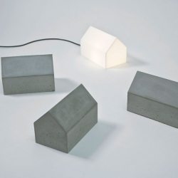 Ceci n'est pas une maison is a lamp and door stop inspired by old Swedish barns, by Arvesund.